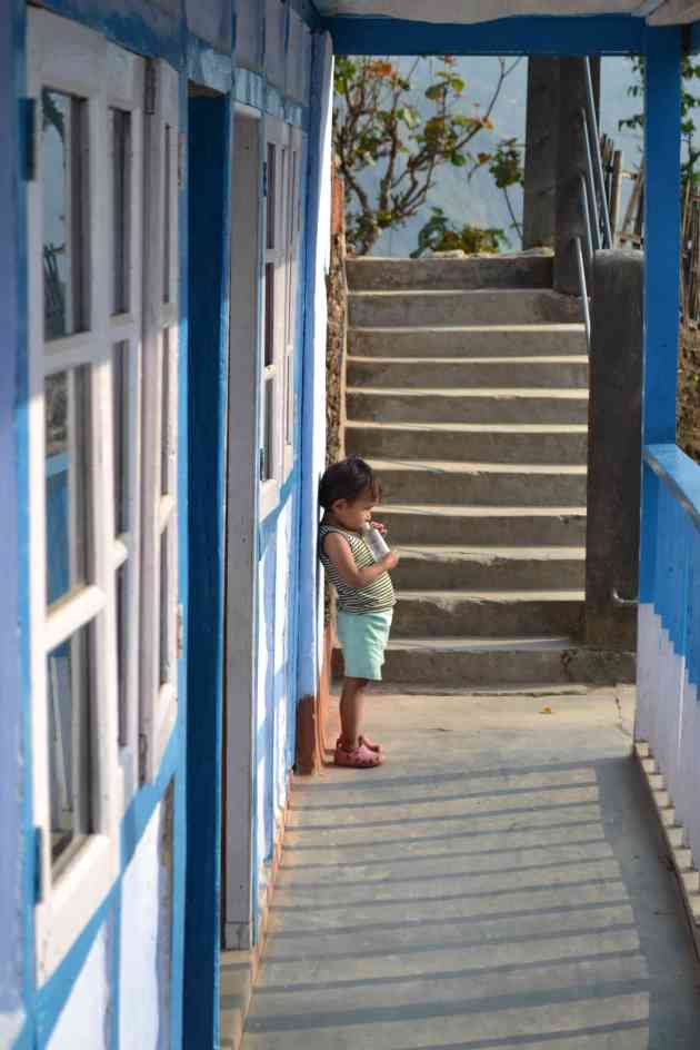 One of the children outside a classroom