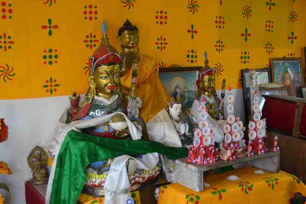 Inside the tiny shrine and meditation room - the Buddha flanked by more ancient gods