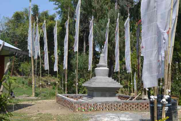 Prayer flags around a new stupa at the entrace to the Gompa