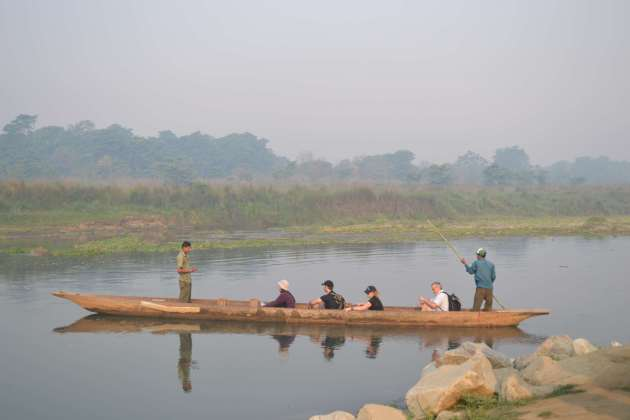 The day begins with a trip up-river by dugout canoe - this a picture of another party