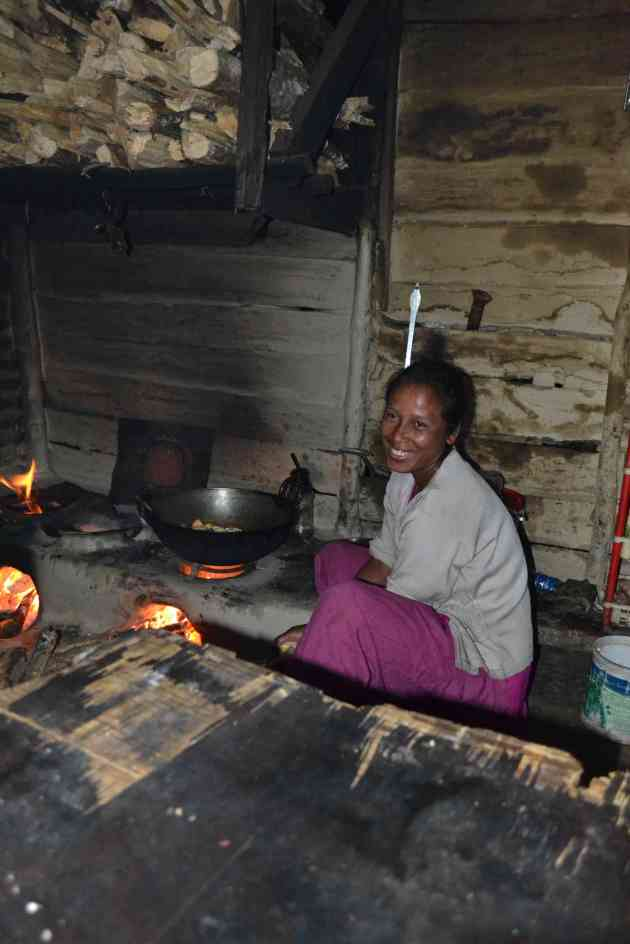 Our hostess, by the wood fuelled hearth.