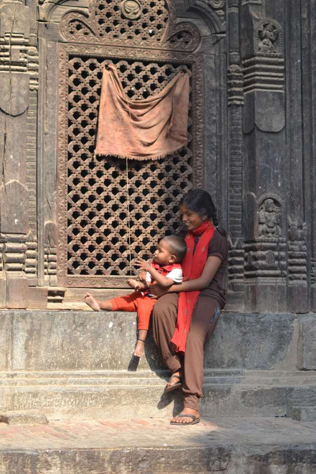 A moment of relaxationfror mother and child - otherwise beggars in the main square at Bhaktapur.