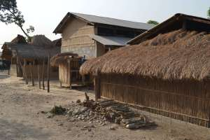 Buildings in the village - note the transition from mud, dung and thatch, to concrete block and tin roof. Sad, one might think, but the thatch has to be replaced every year and mud-walls rebuilt every three - are you going to do it?