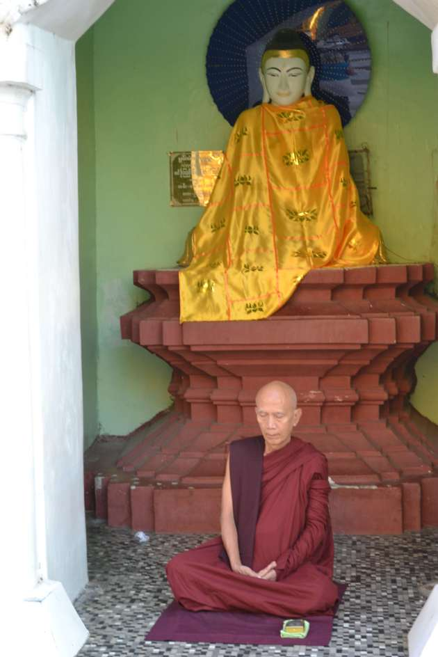 A solitary monk meditates in one of several shrines